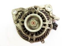 Dirty and Old Automotive alternator, Closeup Stock Photos