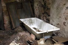 Dirty old bathtub in unsafe House destroyed Royalty Free Stock Image