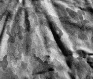 Dirty old black and white camouflage cloth pattern. Stock Photos