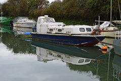 Dirty Old Boats. Old boat on a canal in the countryside Stock Image