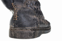 Dirty old boots isolated over white background Royalty Free Stock Image