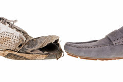 Dirty old boots and new shoes Royalty Free Stock Photography