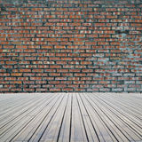 Dirty old bricks wall with wooden floor Royalty Free Stock Image