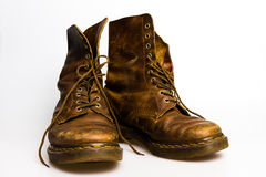 Dirty old brown boots Royalty Free Stock Photos