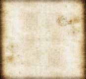 Dirty old canvas paper background Stock Images