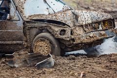 Dirty old car racing with broken radiator. Wreck scrap cars dirt race. Dirty old car racing with broken radiator - coolant leak Stock Photos