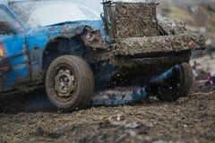 Dirty old car racing in mud. Wreck scrap cars dirt race. Dirty old car racing in mud Stock Photos