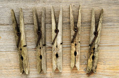 Dirty old clothespins on a wooden board Royalty Free Stock Photos