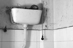 Dirty old flush toilet mechanism. Black and white theme Stock Photography