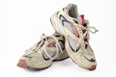 Dirty old gym shoes. stock images