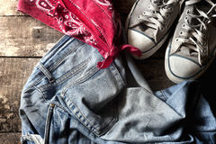 Dirty old jeans. sneakers and bandanna Royalty Free Stock Photo