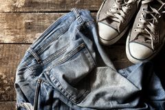 Dirty old jeans and sneakers Royalty Free Stock Images