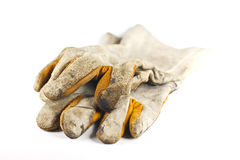 Dirty old leather gloves Stock Photos