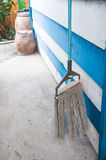 Dirty old mops against blue Stock Images
