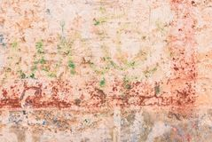 Dirty old rustic plaster wall with weathered color paint. Vintage old dirty wall backdrop texture with weathered paint, close-up stock photo
