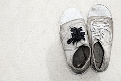 Dirty old shoes Royalty Free Stock Photo