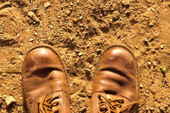 Dirty old shoes on dust floor Royalty Free Stock Image