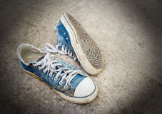 Dirty old shoes on the floor Royalty Free Stock Images