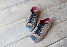 Dirty old shoes on the floor Royalty Free Stock Photography