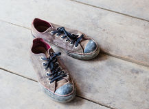 Dirty old shoes on the floor Royalty Free Stock Image