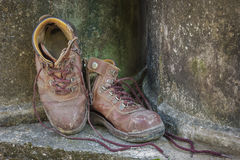 Dirty old shoes on grunge background. Stock Images
