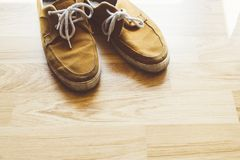 Dirty Old shoes vintage styles. In nice office stock photos