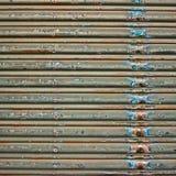 Dirty old Shop Shutter that has seen better days. Stock Photos