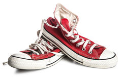 Dirty old sneakers royalty free stock photography