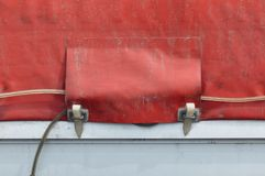 Load securing with lashing strap. Dirty old straps truck and dirty old canvas covered truck. Lashing, strap stock photography
