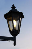 Dirty old street lamp against twilight background Stock Images