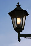 Dirty old street lamp against twilight background Royalty Free Stock Image