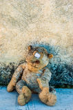 A dirty and old teddy bear Stock Photo