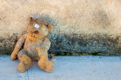 A dirty and old teddy bear Stock Images