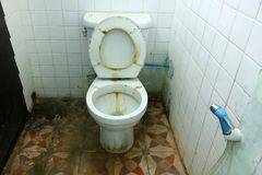 Dirty old toilets bowl and the bathrooms. Is not very clean royalty free stock image