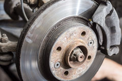 Dirty old used disc brake changing royalty free stock photos