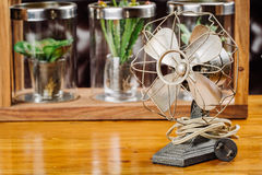Dirty old vintage metal fan  on the table Royalty Free Stock Photography