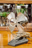 Dirty old vintage metal fan  on the table Stock Photography