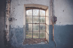 Dirty old window on a grunge wall Stock Photos