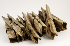 Dirty old wooden clothespins Stock Photos