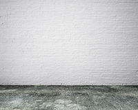 Dirty old wooden floor with white bricks wall, background Royalty Free Stock Photos