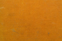 Dirty orange canvas texture Royalty Free Stock Images
