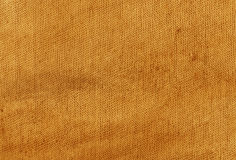 Dirty orange cloth texture. Background and texture for design Royalty Free Stock Photography