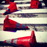Dirty orange cones in the street Royalty Free Stock Image