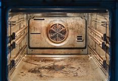 Dirty oven - messy kitchen. Dirty open oven - messy kitchen, Compulsive Hoarding Syndrom royalty free stock photography