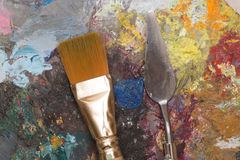 Dirty paint brush and old pallet Stock Image