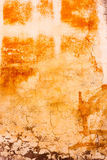 Dirty painted wall. Old  wall with scratched plaster and remains of paint and graffiti Royalty Free Stock Image