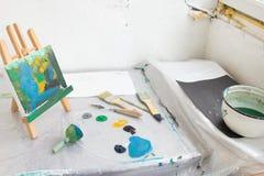 Dirty painter workplace top view. Art studio Stock Photos
