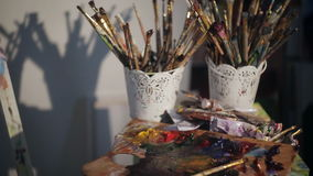 Dirty Palette Knives And Brushes in Art Studio. Art concept. Painting stock video