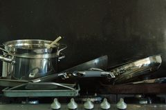 Dirty Pans on a Gas Stove with Black Background 4 royalty free stock photography