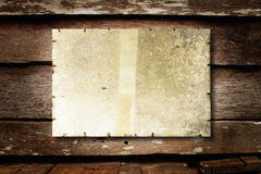 Dirty paper. Old paper on brown wood texture with natural patterns royalty free stock image